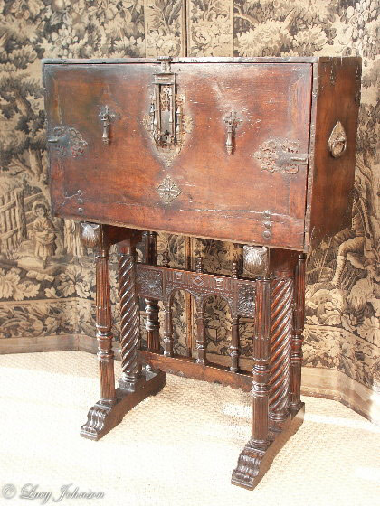A fine, early-17th century, Spanish, walnut bargueno or vargueno-on-stand