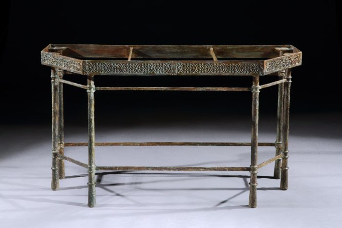 A custom-made bronze console table base made to accomodate a stone top